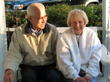 Daddy and Mother sitting outside on a chilly day in 2006.