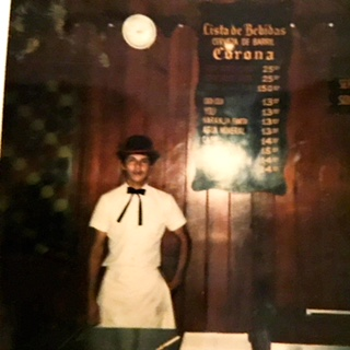 Our waiter at a pizza place in Acapulco. He posed next to the beer menu. Back then, there was no drinking age in Mexico.